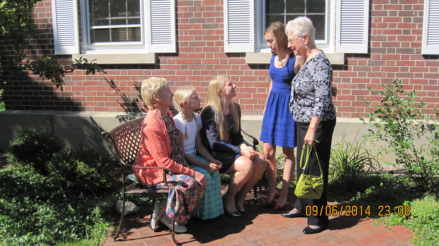 a group of church members gather in garden